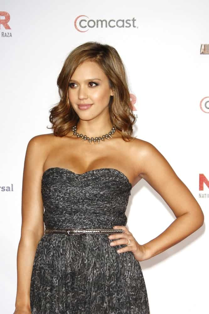 Jessica Alba wore a simple and stylish black dress with her elegant brown hairstyle loose and slightly tousled with elegant curls at the tips at the 2011 NCLR ALMA Awards held at Santa Monica Civic Auditorium on September 10, 2011 in Santa Monica, California.