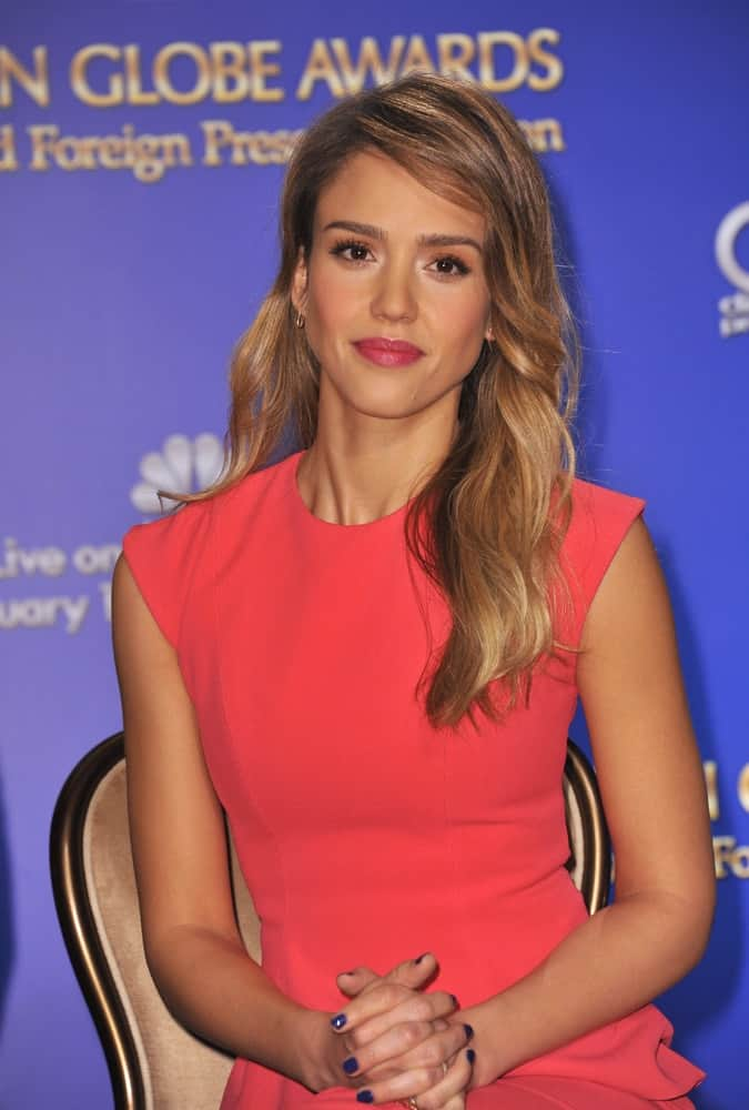 Jessica Alba announced the nominations for the 70th Annual Golden Globe Awards at the Beverly Hilton Hotel on December 13, 2012 Beverly Hills, CA. She wore an elegant and smart red dress that paired well with her long side-swept wavy hairstyle with highlights.