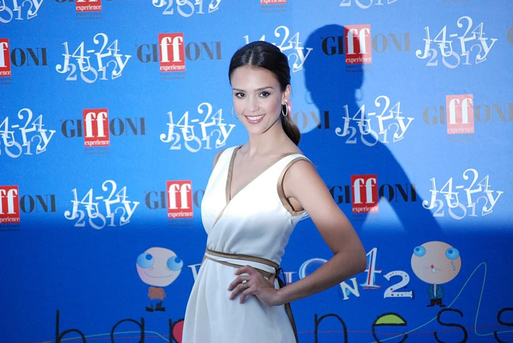 Jessica Alba wore a simple yet lovely white dress with her raven low ponytail hairstyle that has a slick finish to it at the Giffoni Film Festival 2012 on July 14, 2012 in Giffoni Valle Piana, Italy.