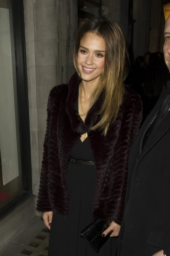 Jessica Alba attended the Salvatore Ferragamo London Flagship Store Launch Party in Old Bond Street, London on December 5, 2012. She wore an all-black attire with a lovely black fur coat to pair with her long, loose and tousled straight brown hairstyle with subtle layers.