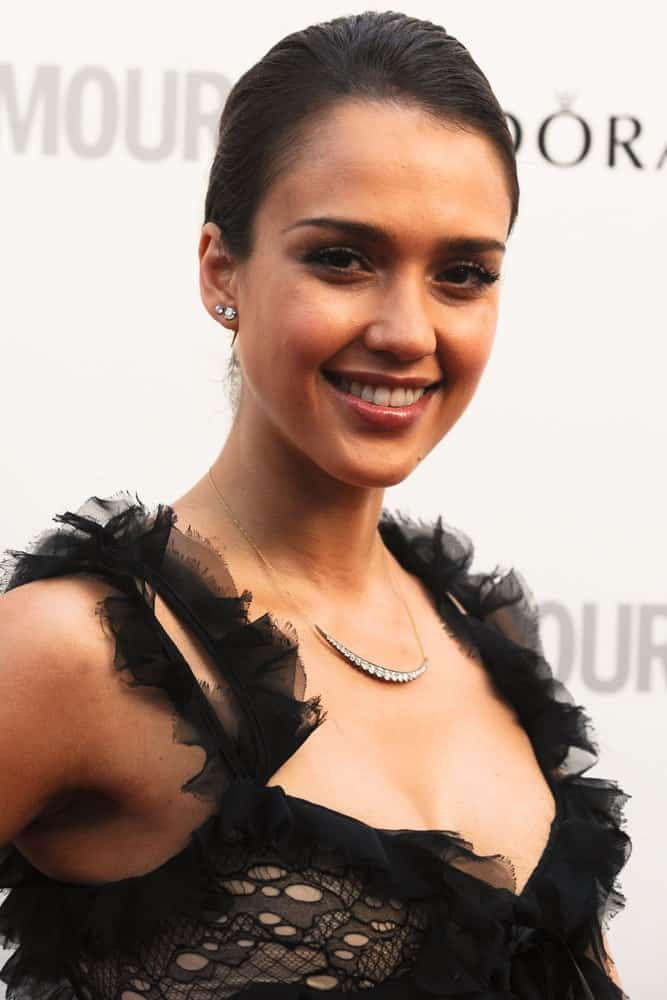 Jessica Alba wore a frilly black dress that went quite perfectly with her slick raven bun hairstyle and bright smile when she arrived at the Glamour Women Of The Year Awards 2012 in Berkeley Square, London on May 29, 2012.