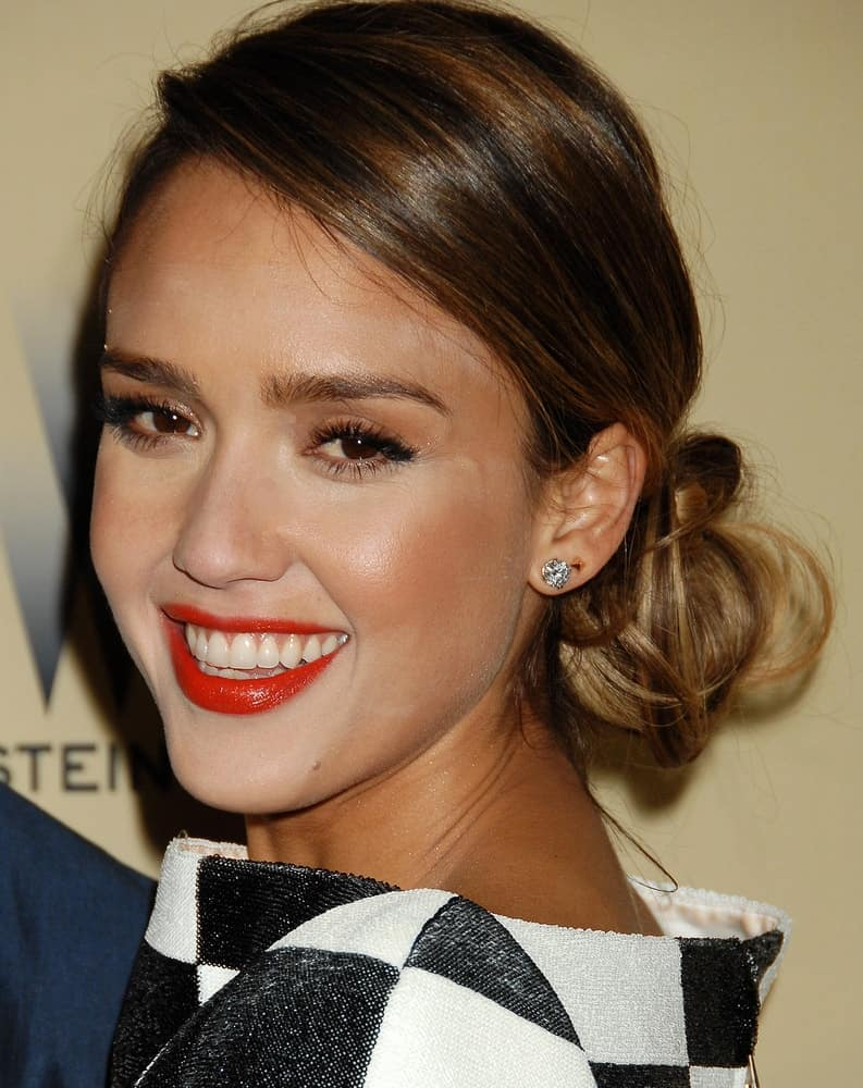Jessica Alba was at the 2013 Weinstein Company Golden Globes After Party on January 13, 2013 in Beverly Hills, CA. She wore a patterned white and black dress that went quite well with her messy low bun hairstyle incorporated with long side-swept bangs.