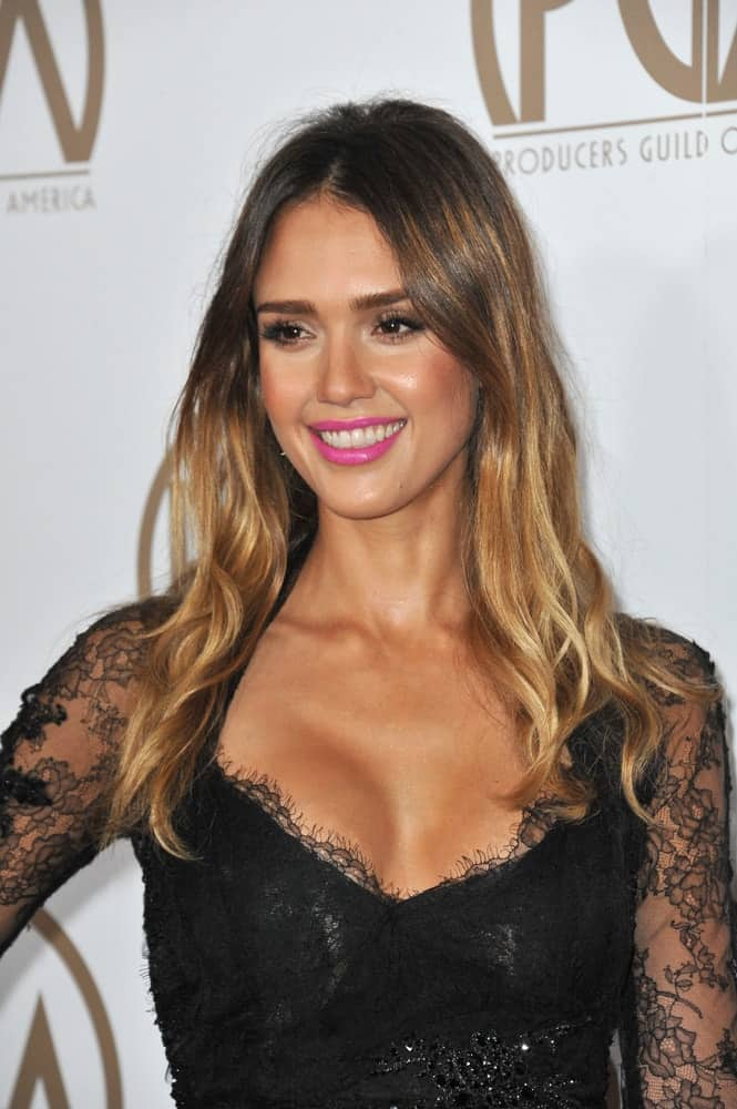On January 26, 2013, Jessica Alba wore a black sheer dress that is complemented by her gorgeous long, wavy and highlighted hairstyle loose on her shoulders at the 2013 Producers Guild Awards at the Beverly Hilton Hotel.