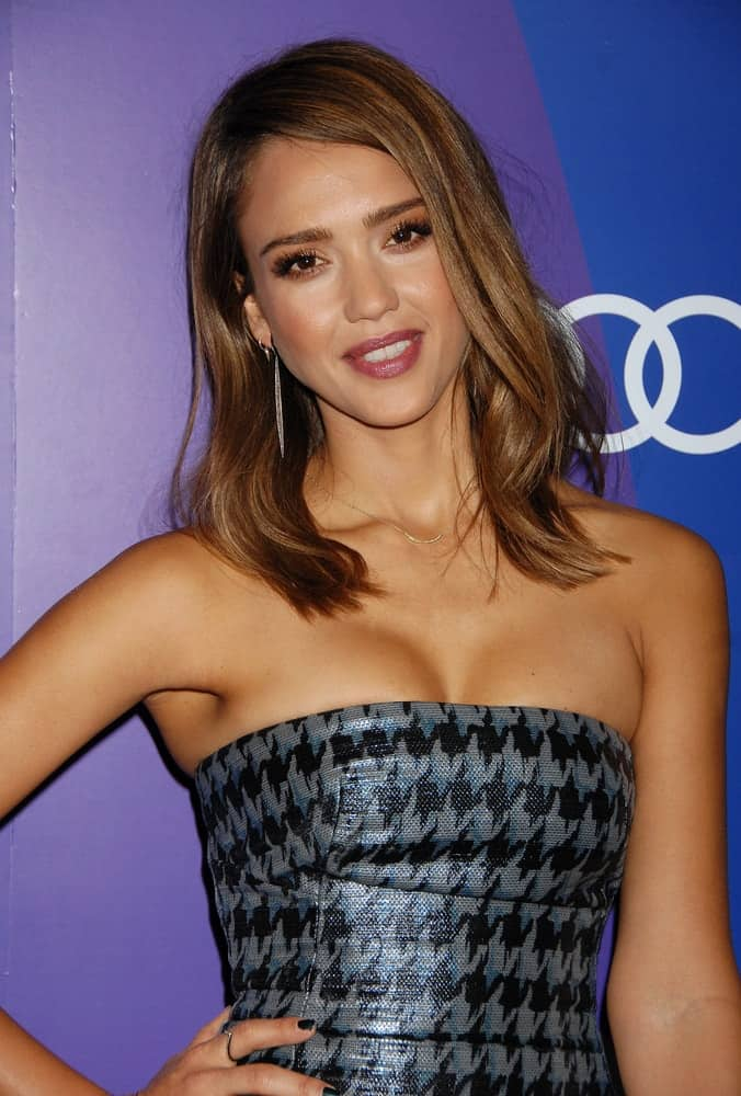 Jessica Alba wore a stylish patterned strapless dress with her loose and tousled medium-length hairstyle with highlights and subtle waves when she arrived at the Variety 5th Annual Power of Women Event on October 4, 2013 in Beverly Hills, CA.