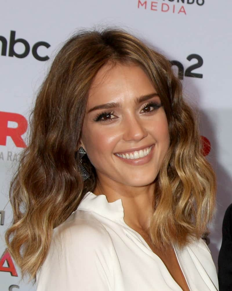 Jessica Alba wore a simple yet elegant white blouse with her medium-length tousled, wavy and highlighted loose hairstyle at the 2013 ALMA Awards - Press Room at Pasadena Civic Auditorium on September 27, 2013 in Pasadena, CA.