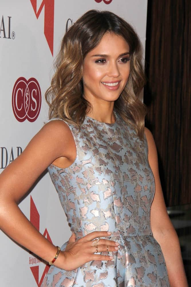 Jessica Alba wowed everyone with her gorgeous yet simple make-up and shoulder-length wavy highlighted brown hairstyle at The Helping Hand of Los Angeles Mother's Day Luncheon at Beverly Hilton Hotel on May 9, 2014 in Beverly Hills, CA.
