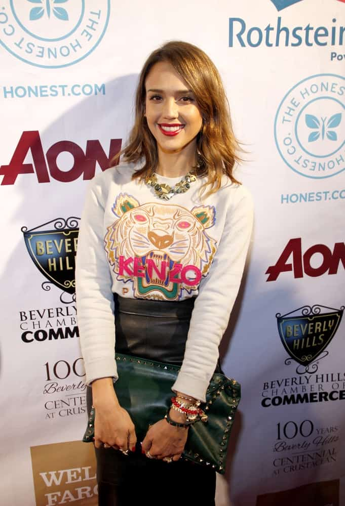 Jessica Alba wore a black leather skirt with her casual shirt, red lips and tousled shoulder-length wavy brown hairstyle with long side-swept bangs at the City of Beverly Hills Centennial Anniversary held at the Crustacean in Los Angeles on February 5, 2014 in Los Angeles, California.