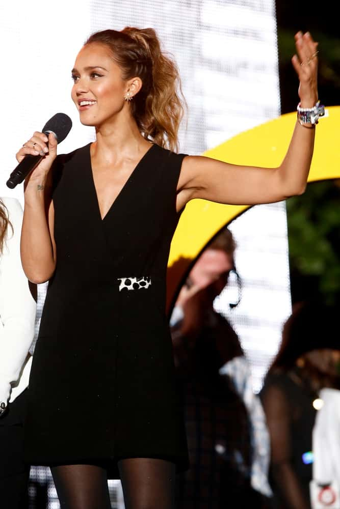Actress Jessica Alba spoke onstage at the 2014 Global Citizen Festival to end extreme poverty by 2030 in Central Park on September 27, 2014 in New York City. She wore a simple yet lovely black dress that she paired with a high ponytail that has brown waves at the tips.