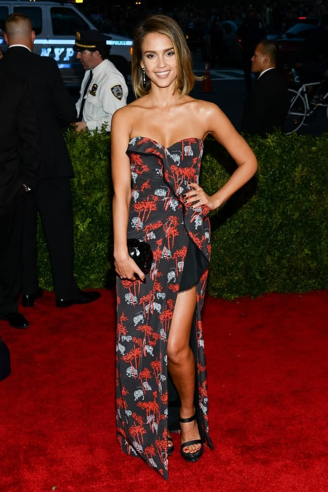On May 04, 2015, Jessica Alba attended the 'China: Through The Looking Glass' Costume Institute Gala, held at the Metropolitan Museum of Art in New York City, New York. She wore a long patterned black dress with her short, highlighted bob hairstyle with side-swept bangs.