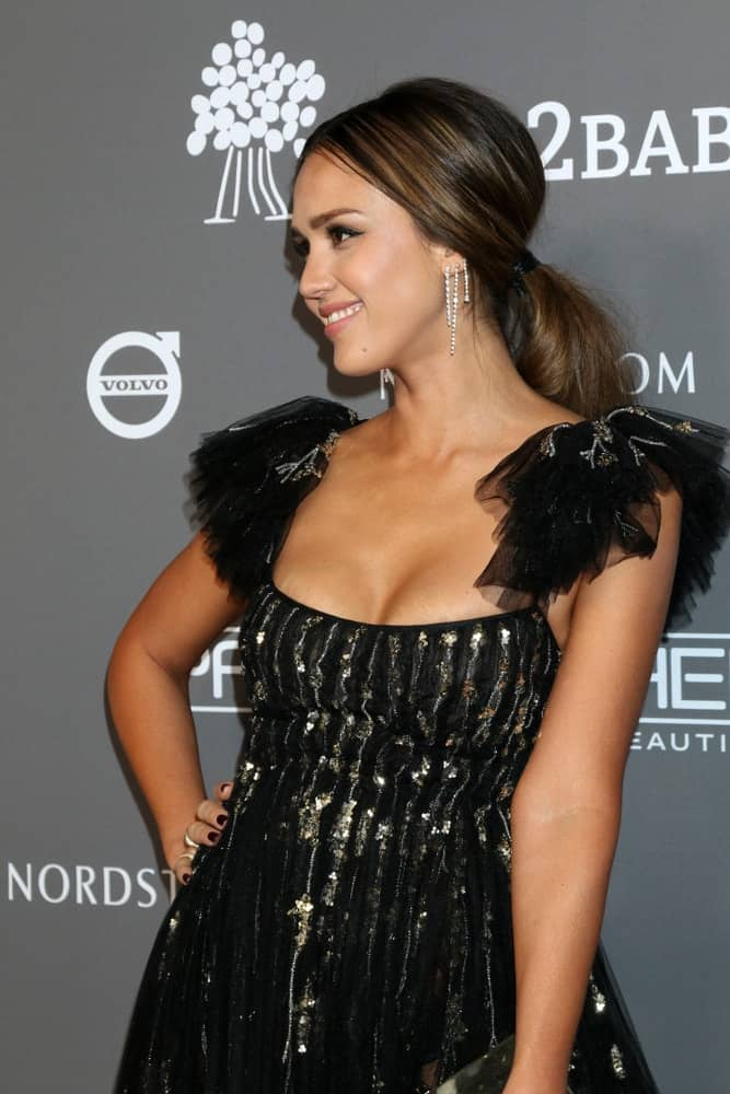 Jessica Alba was quite lovely in her black sequined dress and highlighted ponytail hairstyle at the 2018 Baby2Baby Gala at the 3Labs on November 10, 2018 in Culver City, CA.