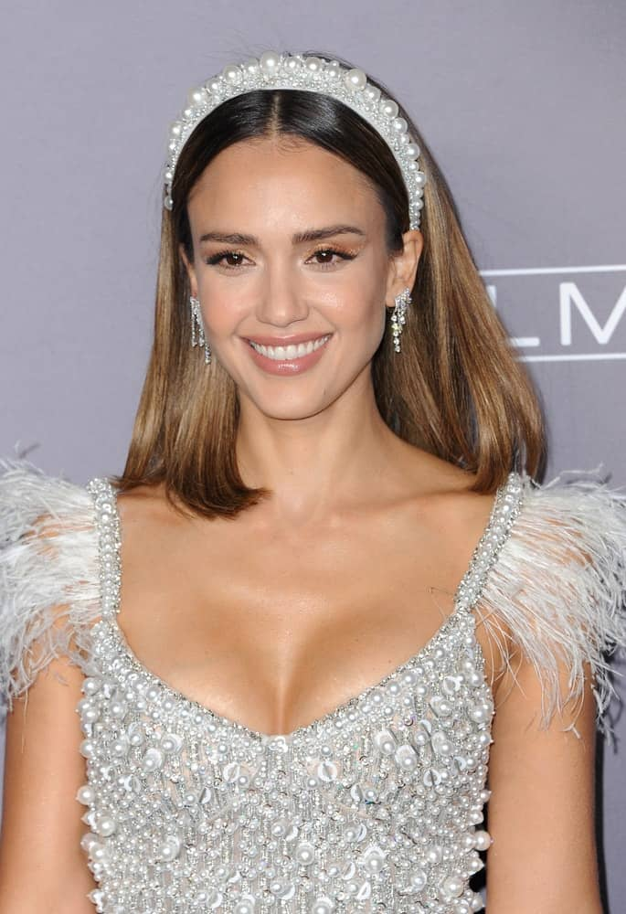 Jessica Alba paired her pearly dress with a pearly headband that adorns her shoulder-length straight brown hair with subtle highlights at the 2019 Baby2Baby Gala Presented By Paul Mitchell held at the 3LABS in Culver City, USA on November 9, 2019.