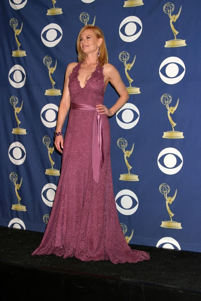 Kristen Bell during the 2005 Primetime Emmy Awards at Shrine Auditorium on September 18, 2005. She wore a pink halter dress that she paired with a simple straight hairstyle.