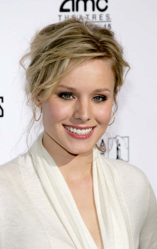 Kristen Bell exhibited a glamorous look with her messy highlighted upstyle hairstyle at the Los Angeles premiere of 'The Producers' held at the Westfield Century City on December 12, 2005.