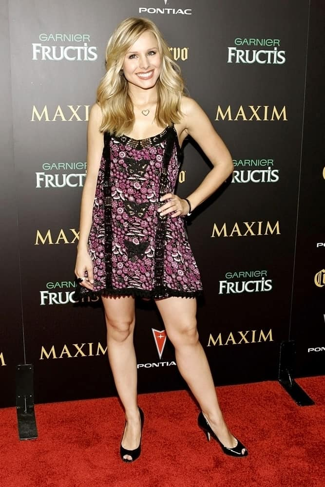 Kristen Bell flaunted her voluminous loose waves that she paired with a short printed dress at the Maxim Hot 100 Party held at Buddha Bar, New York, NY on May 17, 2006.