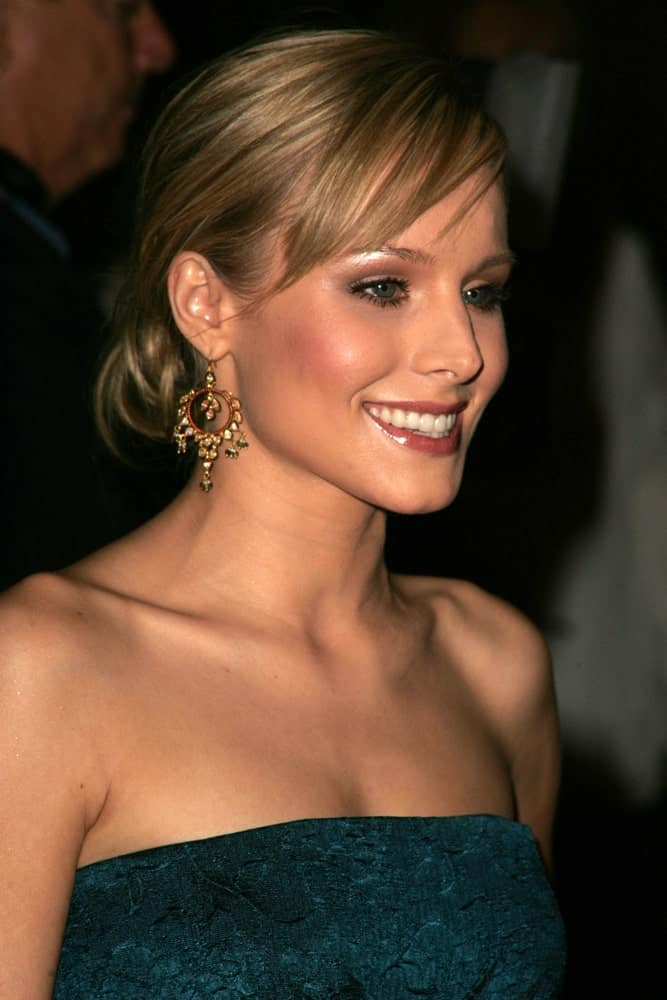 Kristen Bell opted for a classy look featuring her low bun hairstyle with side-swept bangs at the