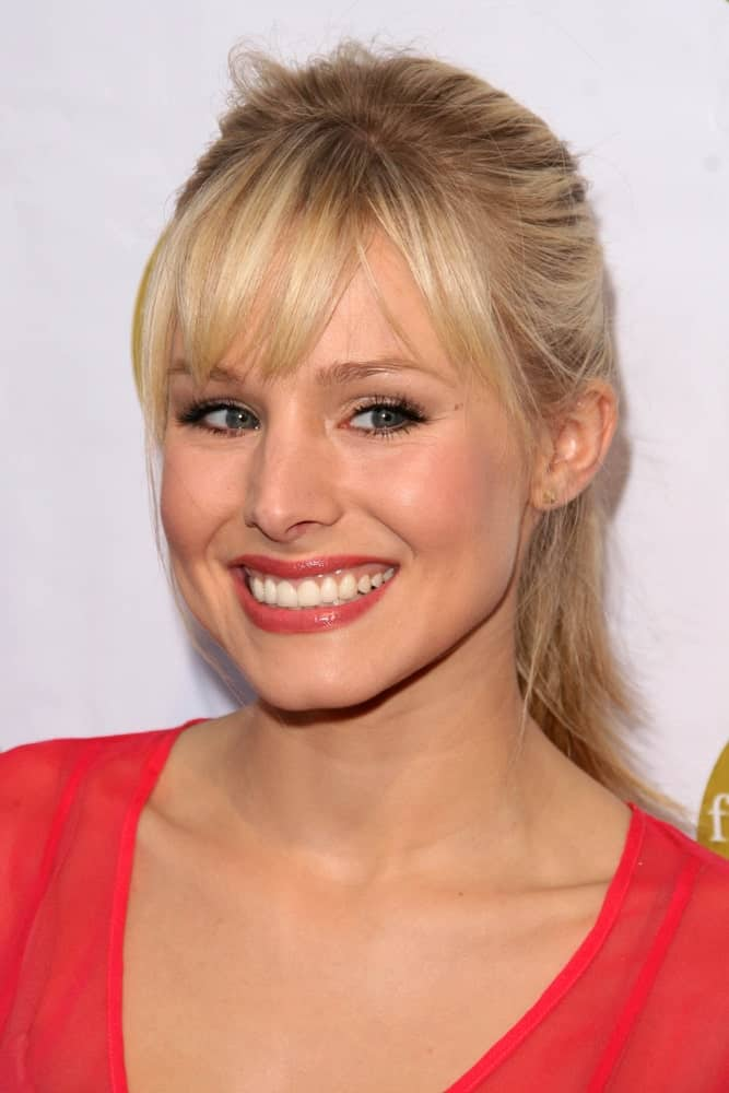 Kristen Bell incorporates her messy high ponytail with bangs at the 5th Annual Friends of El Faro Benefit to raise funds for the children of Tijuana Casa Hogar Sion Orphanage on August 7, 2008.