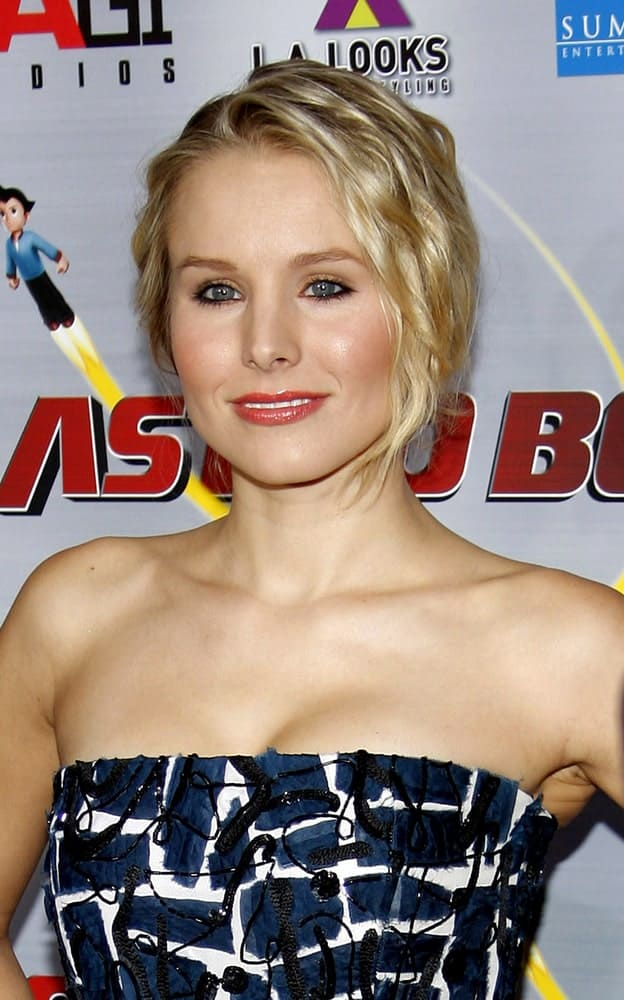 Kristen Bell in a bold printed tube dress that goes perfectly well with her curly upstyle at the Los Angeles premiere of 'Astro Boy' held at the Mann Chinese 6 in Los Angeles on October 19, 2009.