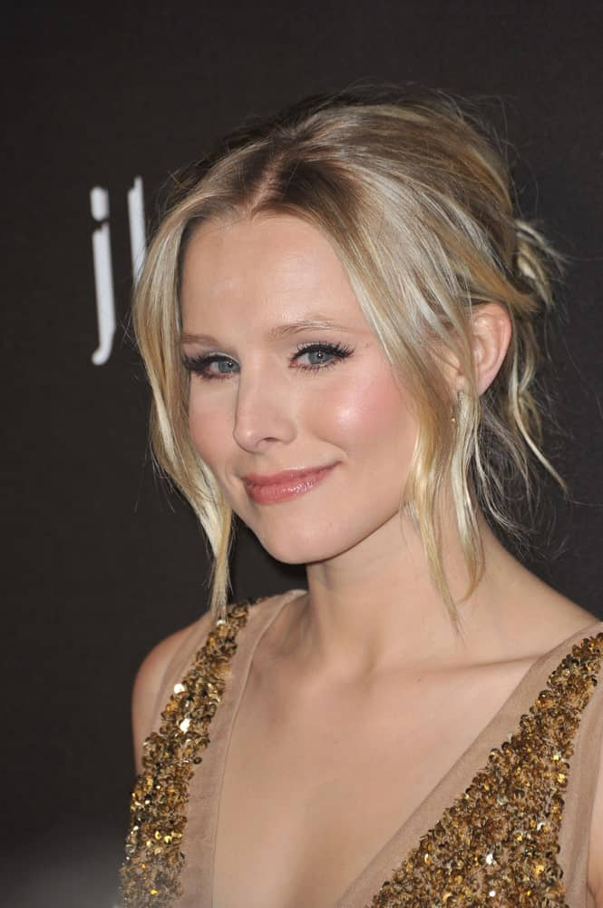 Kristen Bell with her blonde locks arranged into a messy upstyle with loose tendrils at the 12th Annual Costume Designers Guild Awards at the Beverly Hilton Hotel on February 25, 2010.
