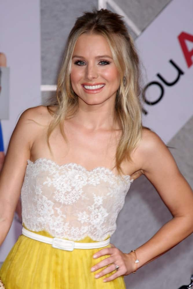 Kristen Bell looked charming in a tube lace dress along with a messy half upstyle at the