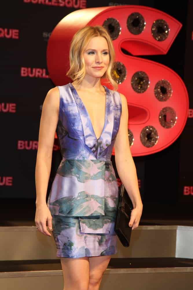 Kristen Bell exhibited a classy look with her short deep V neck dress and a wavy loose updo at the Germany Premiere of 'Burlesque'held on December 16, 2010.
