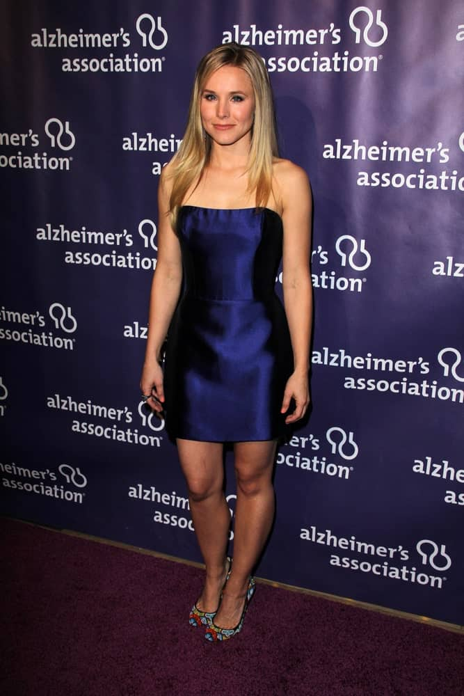 Kristen Bell had a sleek straight hairstyle that she paired with a short navy blue gown at the 20th Anniversary Alzheimer's Association