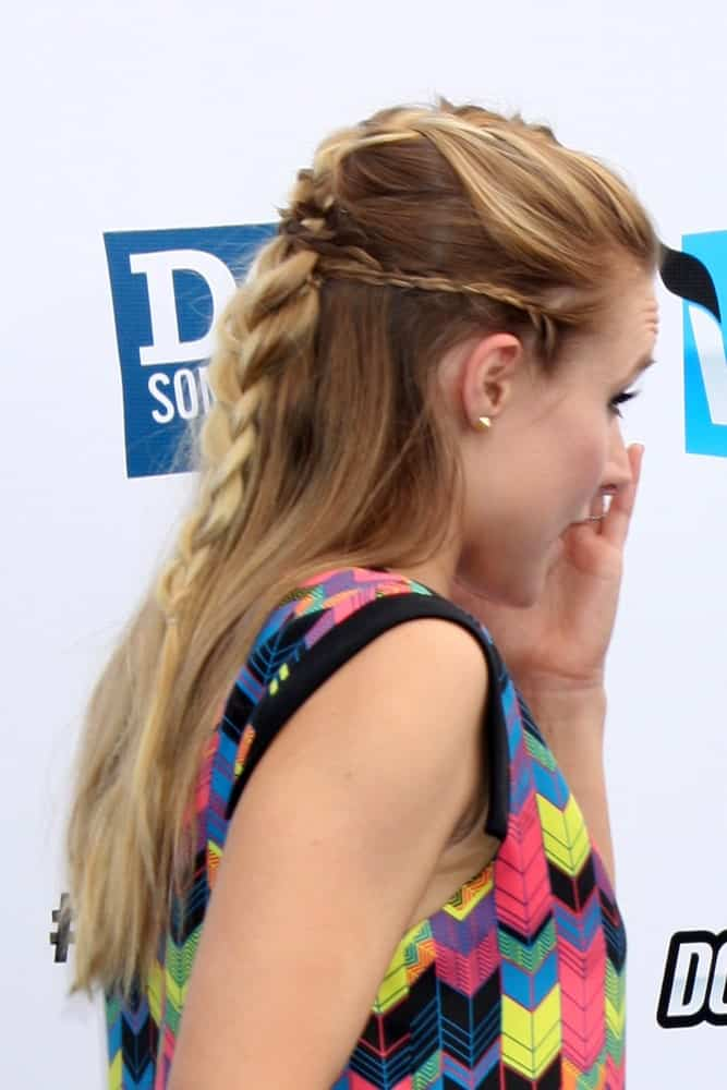 Actress Kristen Bell shows the side profile of her braided half-updo last August 19th, during 2012 Do Something Awards at Barker Hanger in Santa Monica, CA.