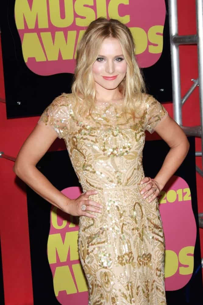 Kristen Bell with her mid-length center-parted waves matched with gold embellished gown at the 2012 CMT Music Awards on June 6th in Bridgestone Arena, Nashville TN.