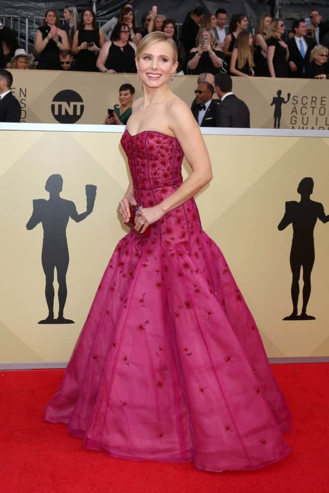 Kristen Bell looked gorgeous in a magenta gown that she paired with a neat upstyle at the 24th Screen Actors Guild Awards held on January 21, 2018, in Los Angeles, CA.