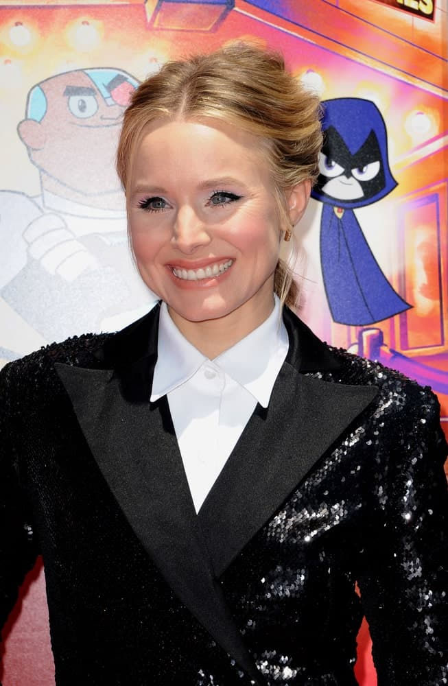 Kristen Bell was seen at the Los Angeles premiere of 'Teen Titans Go! To The Movies' held at the TCL Chinese Theatre IMAX on July 22, 2018, rocking a center-parted upstyle with side tendrils.