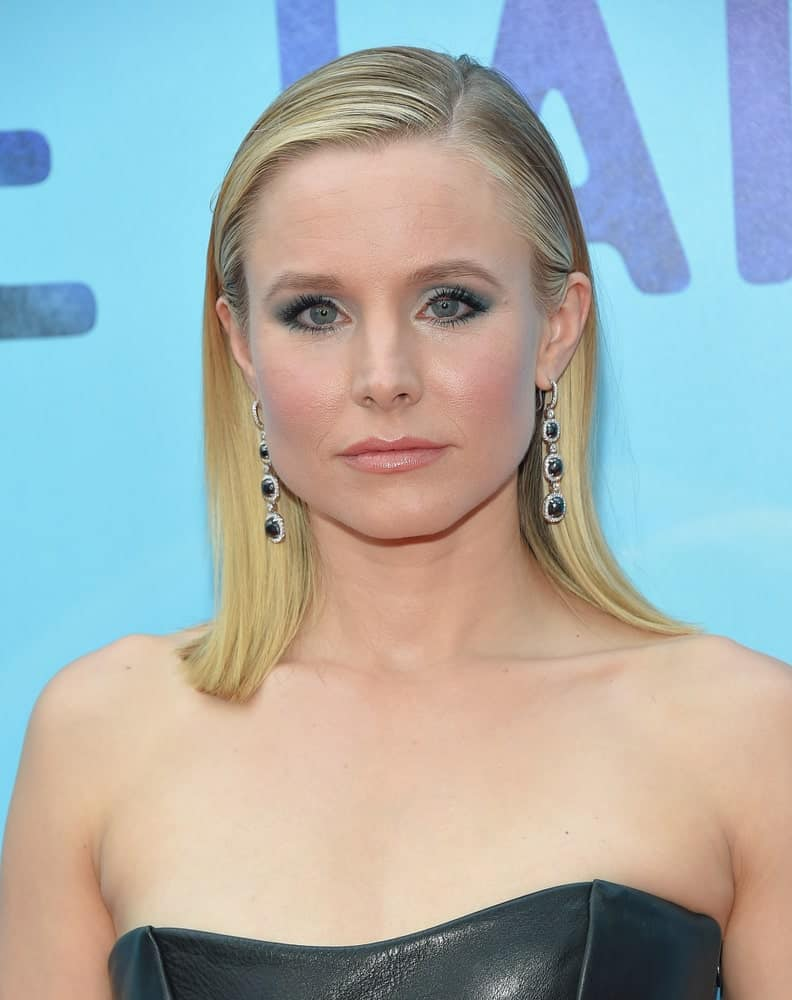 Kristen Bell exhibited a sultry look showcasing her slick side-parted hair and a black leather dress at the 'Like Father' Los Angeles Premiere on July 31, 2018, in Hollywood, CA