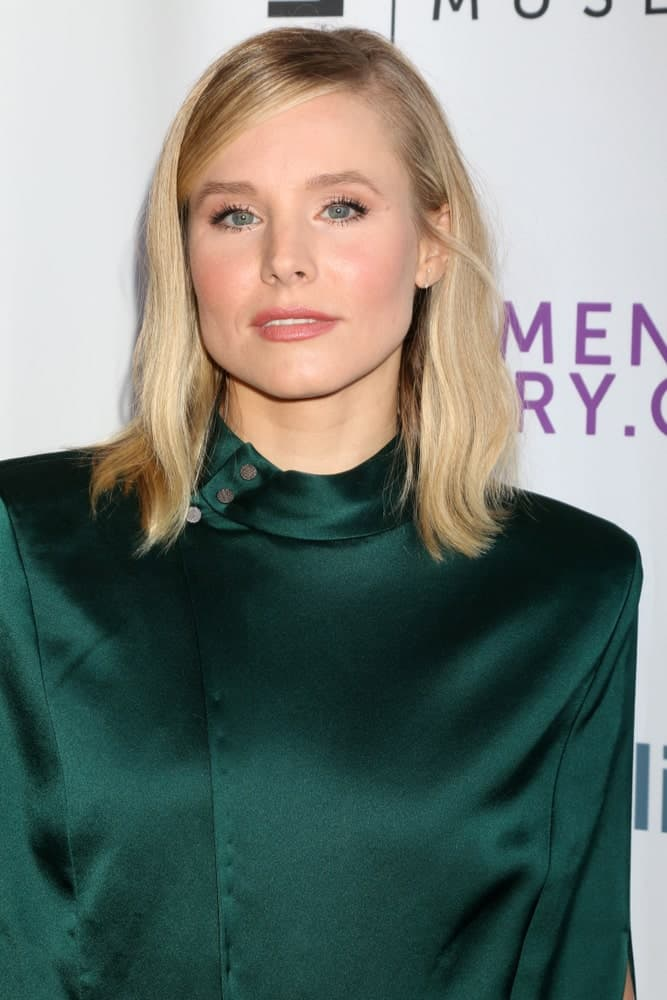 Kristen Bell looked sophisticated in an emerald dress that complements her side-parted casual waves at the Women Making History Awards 2018 at the Beverly Hilton Hotel on September 15, 2018.