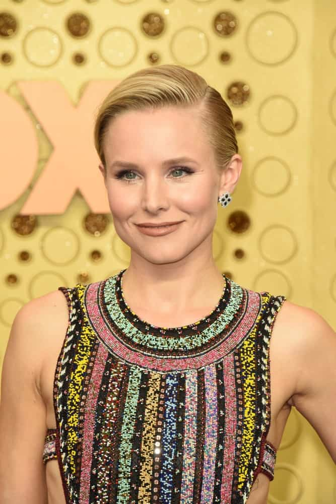 Kristen Bell in a colorful dress along with a side-swept updo as she attends the Primetime Emmy Awards at the Microsoft Theater on September 22, 2019.