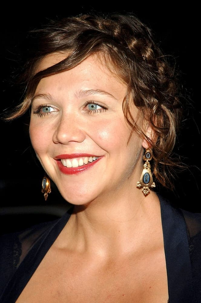 Maggie Gyllenhaal was at the Premiere of World trade Center at the Ziegfeld Theater in New York, NY on August 03, 2006. She wore a black dress with her messy upstyle with halo braids.