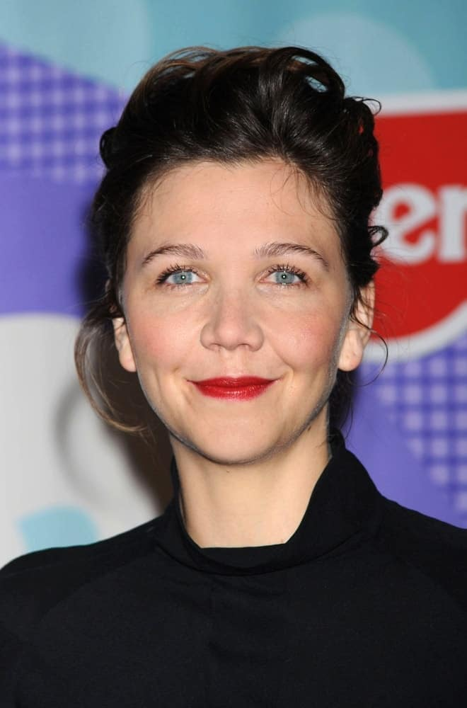 Maggie Gyllenhaal attended the press conference for Fisher-Price Launch of the Precious Planet BabyGear Collection in New York, NY on January 27, 2009. She wore a simple black outfit with her messy dark ponytail hairstyle with loose tendrils.