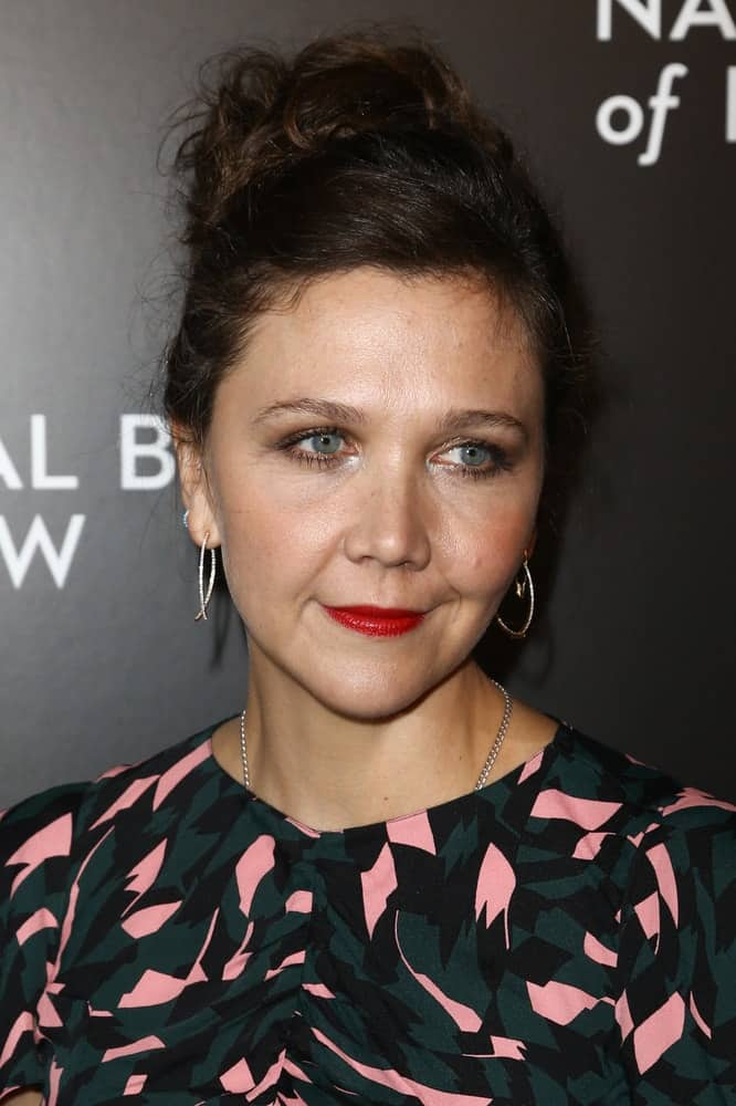Actress Maggie Gyllenhaal attended the National Board of Review Gala at Cipriani Wall Street in New York on January 4, 2017. She was charming in a patterned dress and messy dark bun hairstyle.
