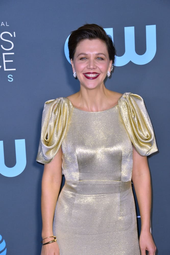On January 13, 2019, Maggie Gyllenhaal attended the 24th Annual Critics' Choice Awards in Santa Monica. She paired her metallic dress with a slick side-parted pixie hairstyle with a slight pompadour finish.