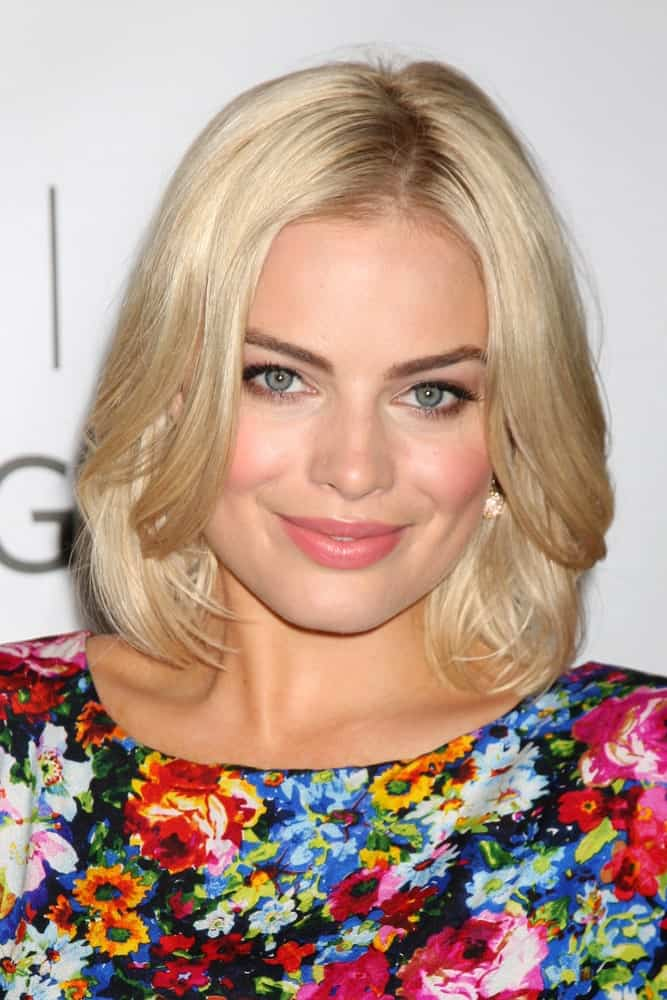 Margot Robbie wore a colorful floral dress along with her short blonde center-parted hair at the Disney/ABC Television Group Summer Press Tour at the Beverly Hilton Hotel on August 7, 2011.