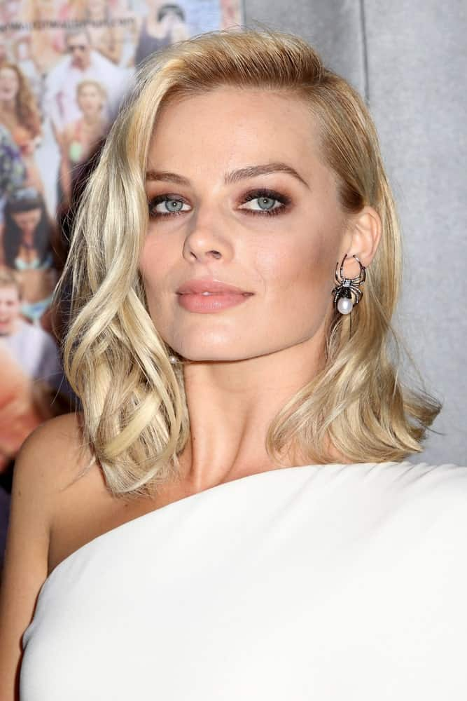 Margot Robbie with her carefree blonde waves styled with a side-swept 'do during the premiere of