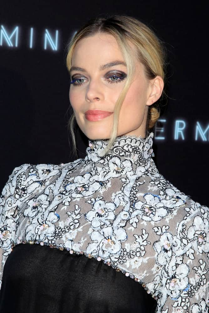 Margot Robbie had a low bun hairstyle with loose tendrils at the