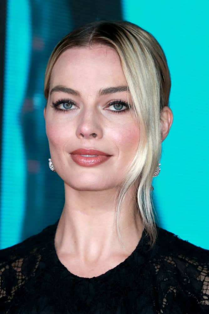 Margot Robbie pulled off a neat center-parted upstyle with long side tendrils as she attends the British Academy Film Awards at the Royal Albert Hall on February 2, 2020.