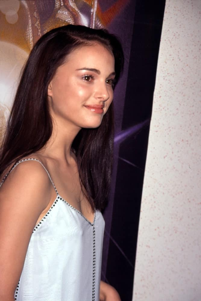 A young Natalie Portman wore a Gucci dress to pair with her straight, loose and long side-swept raven hair at the New York charity premiere of Star Wars: The Phantom Menace on May 16, 1999.