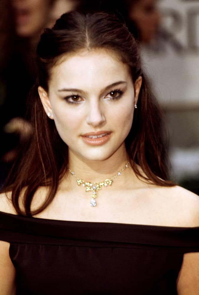 Natalie Portman's medium-length dark hair was styled into a lovely straight half-up hairstyled to match her black off-shoulder outfit at the Golden Globe Awards back in January of 2000.