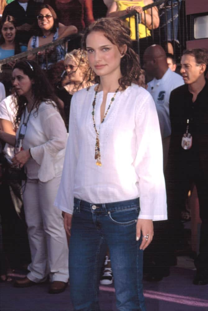 Natalie Portman paired her white blouse and jeans with a curly brown half-up hairstyle at the MTV Movie Awards held in Los Angeles, California on June 1, 2002.