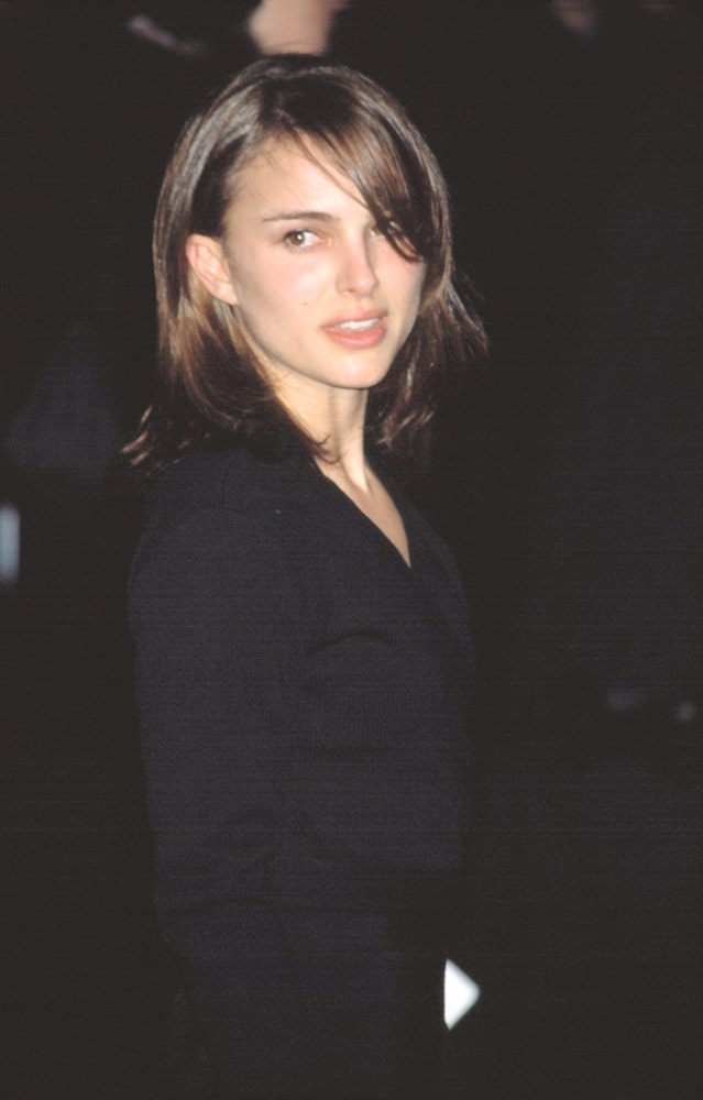 Natalie Portman was quite charming in her shoulder-length dark hairstyle with a loose and tousled finish and side-swept bangs covering one eye at the premiere of GANGS OF NEW YORK in New York on December 9, 2002.