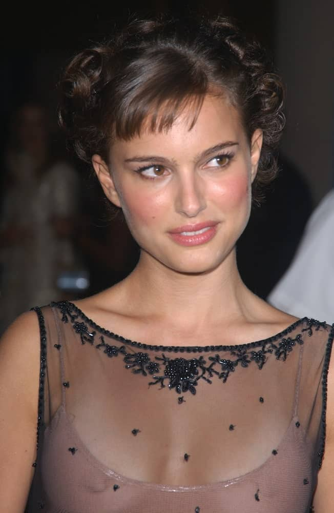 Actress Natalie Portman wore a stunning sheer outfit that went perfectly well with her upstyle that is incorporated with curls and braids at the 18th Annual American Cinematheque Gala honoring Nicole Kidman on November 14, 2003.