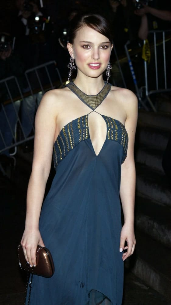 Actress Natalie Portman attended the Costume Institute Party of the Year at the MET April 26, 2004 in New York City. She wore a stunning blue dress that complements her slick bun hairstyle with a side-swept bangs.