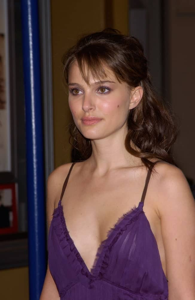 On November 22, 2004, actress Natalie Portman was at the Los Angeles premiere of her new movie Closer. She came wearing a stunning blue dress and loose, tousled half-up hairstyle with wispy bangs.