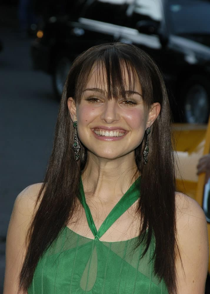 Actress Natalie Portman wore a lovely green dress to pair with her loose long dark straight hair with wispy bangs at the FRESH AIR FUND'S ANNUAL SPRING GALA honoring American Heroes at Tavern on the Green on June 3, 2004 in New York City.