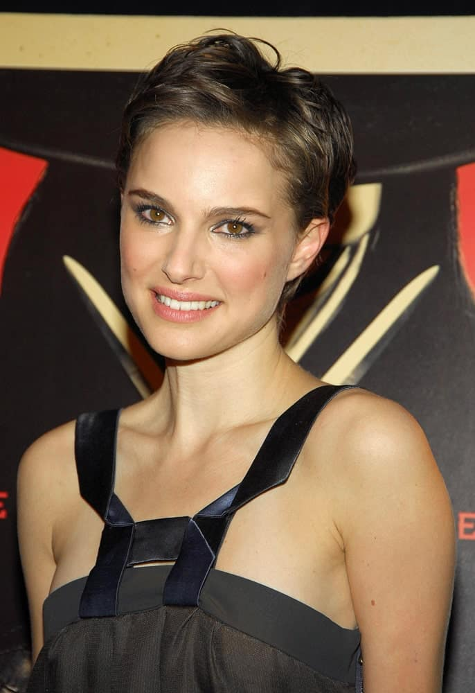 Natalie Portman was quite stunning in her simple gray dress and side-swept pixie hairstyle with subtle highlights at the V FOR VENDETTA Premiere, Jazz at Lincoln Center Rose Theater in New York, NY on March 13, 2006.