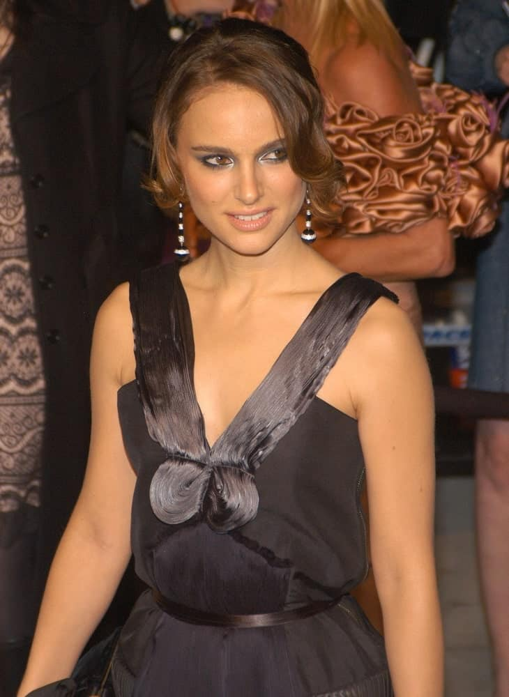 Natalie Portman wore a Lanvin black dress with her bun hairstyle that has loose long curtain bangs that has curls at the tips at the 2007 Vanity Fair Oscar Party in Mortons Restaurant, Los Angeles, CA on February 25, 2007.